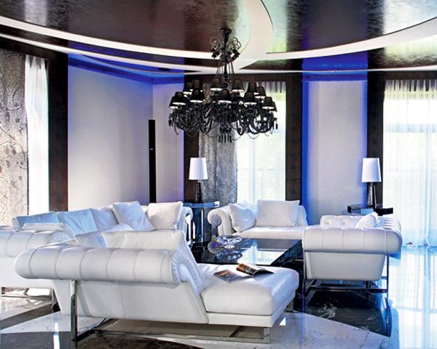 modern interior design and luxury apartment decorating ideas inwhite leather furniture for living room, classic chandelier and contemporary led lights for ceiling design
