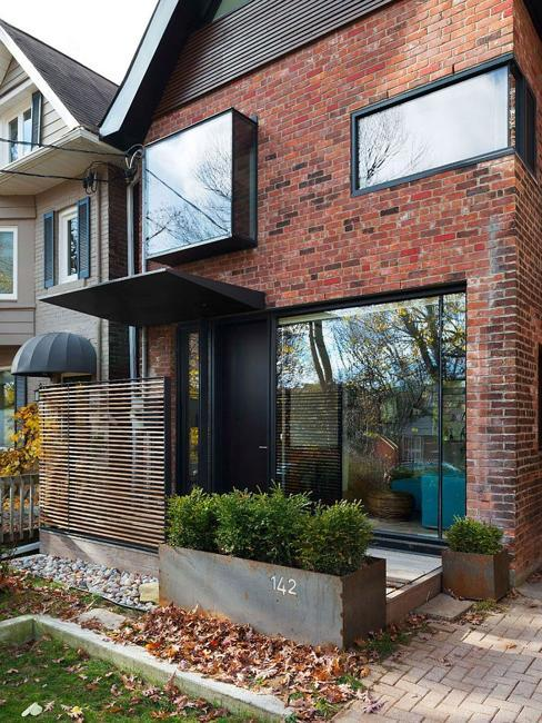 house exterior redesign, vintage brick walls and large windows