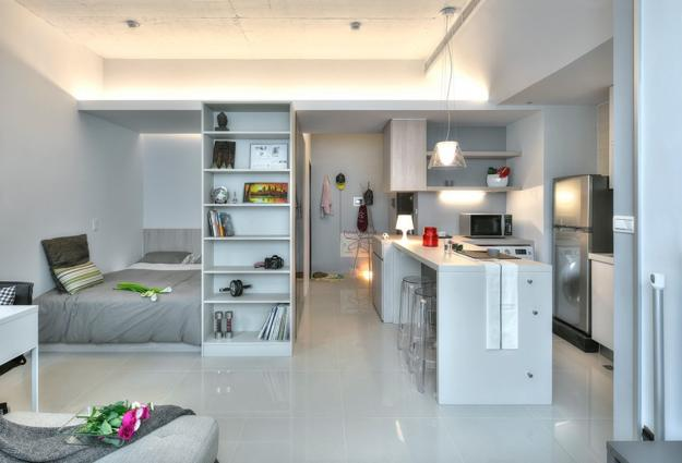 Small Kitchen Design And Sleeping Area Separated By Shelves As Room Dividers