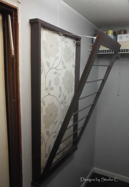 Ingeniously Simple Door With Metal Rods For Drying Clothes
