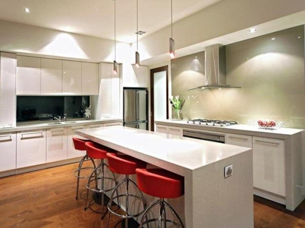 White Kitchen With Red Chairs