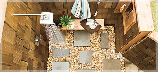 Wooden Shower Enclosure With Stones And Concrete Slabs On The Floor