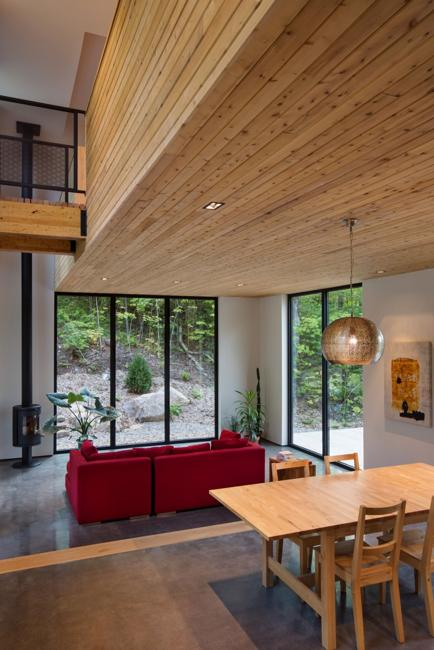 Wooden House Design With Beautiful Interiors Accentuated By Red Accents