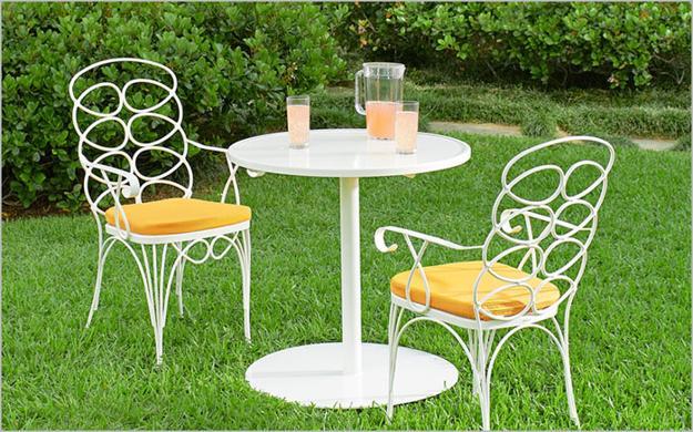 Stone Patio Design With White Iron Furniture Set In Vintage Style