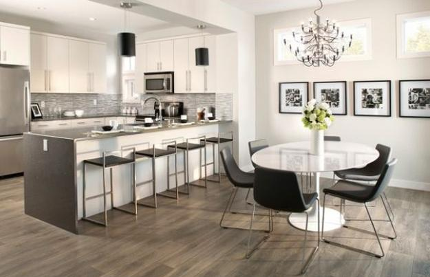 Modern Kitchen And Dining Room With White Tulip Tables And Black Chairs