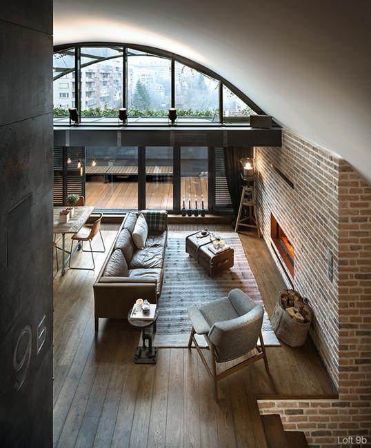 Modern Loft Living Space With High Arched Ceiling And Exposed Brick Wall