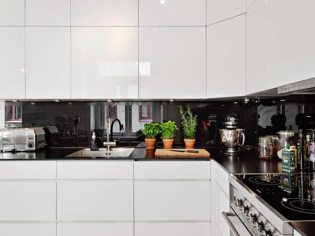 Black and white kitchen cabinets with thin countertops and contemporary lighting & 6 Kitchen Trends You May Overlook Modern Kitchen Design Trends
