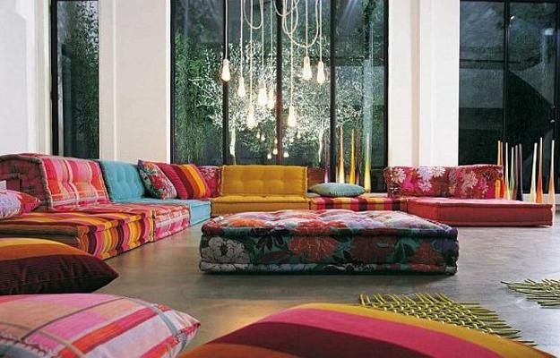 Modern Sofas Made Of Colorful Upholstery Fabrics Decorative Pillows And Ottoman In Bright Colors