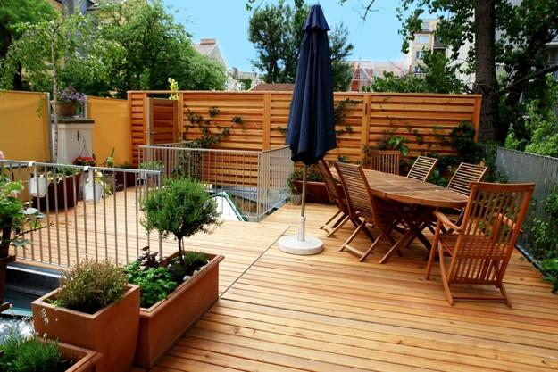 Terrace With Wooden Deck And Dining Furniture