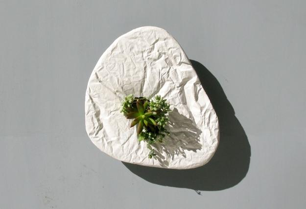 modern wall decorating with concrete planters and indoor plants