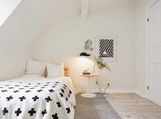 small bedroom decorating in white and black, sross and striped decoration patterns