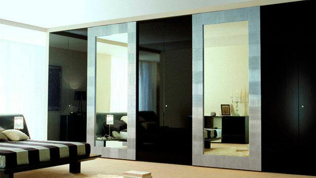 Mirrored Surfaces And Wood Texture For Closet Door Decoration
