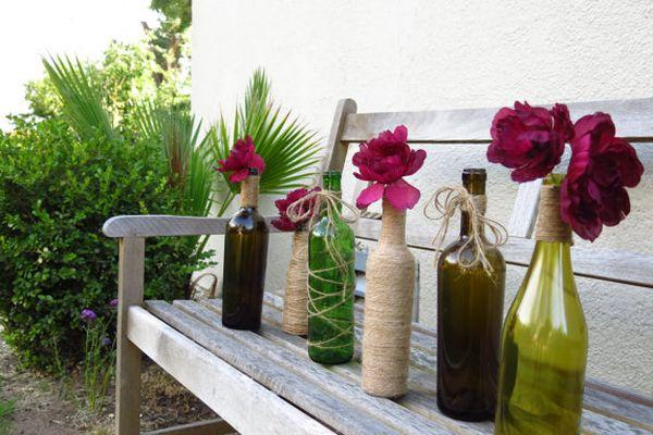 flower arrangements, table decorations and centerpieces in glass bottles