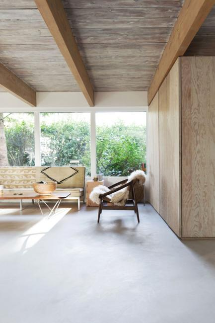 architectural interiors with open wooden shelves, ceiling beams, plywood room dividers