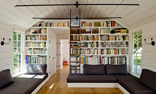 Rolling Ladder And Open Bookshelves In Attic Library