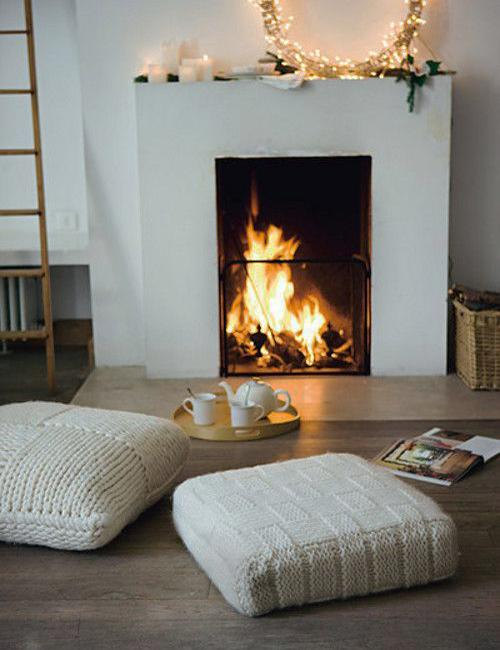 Informal Room Decorating Around A Fireplace Floor Cushions