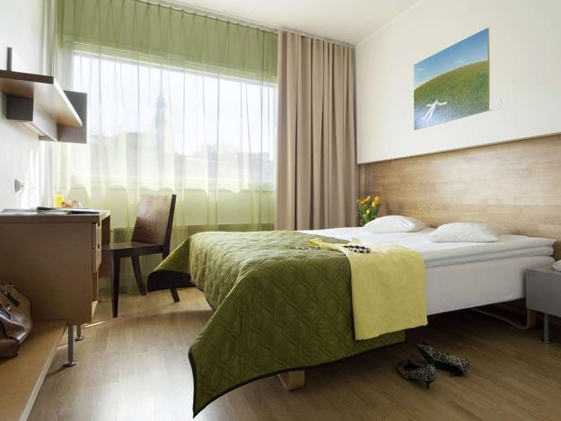 green bedroom decorating with light yellow and blue accents