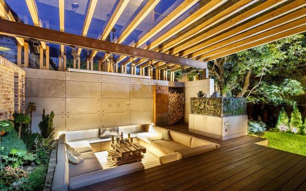 Outdoor seating area with concrete fireplace - Stylish Backyard Ideas Creating Cozy Outdoor Seating Area And Open