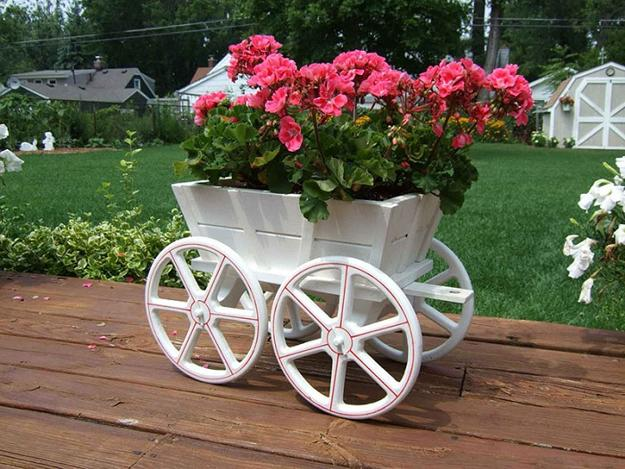 Cart On Wheels With Pink Geranium Flowers