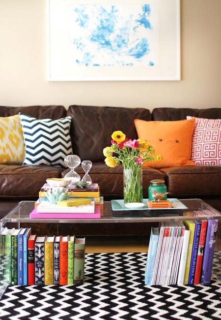 living room decorating with colorful pillows and books