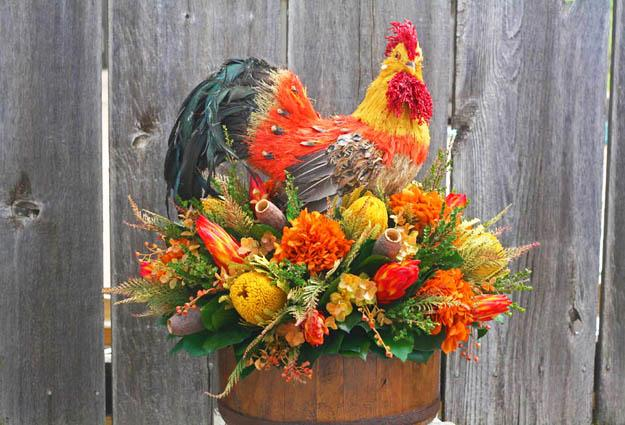 Flower Arrangements And Rooster Accents Creating Bold Jazzy Table Centerpieces