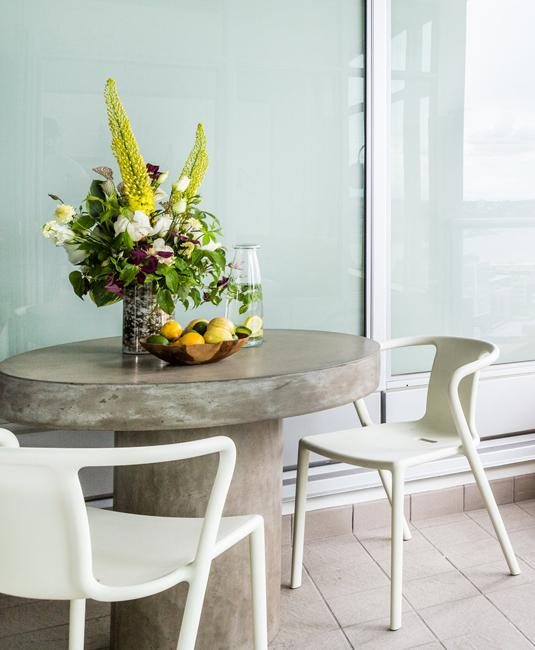 concrete dining table with floral centerpiece