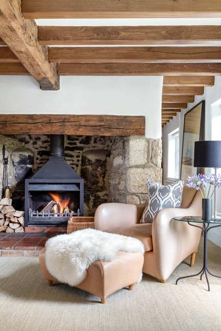 living room design with fireplace and exposed ceiling beams