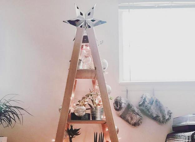 wooden ladder with shelves decorated with snow and christmas ornaments - Christmas Shelf Decorations