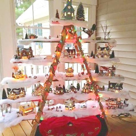 wooden ladder with shelves decorated with snow and christmas ornaments