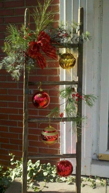wood ladder with suspended christmas balls and evergreen branches - Christmas Ladder Decor