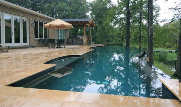 Negative edge swimming pools offering impressive designs for Pool design jacksonville fl