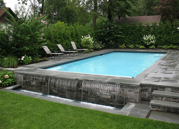 Negative edge pool designs and spillover waterfalls - Luxury above ground pools ...