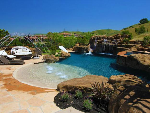 Beach Style Pool Designs Creating a Lake Effect in Modern Yards