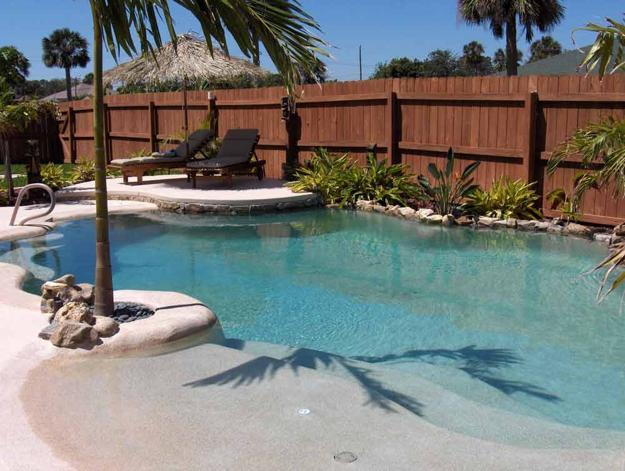 Beach style pool designs creating a lake effect in modern for Pool design types