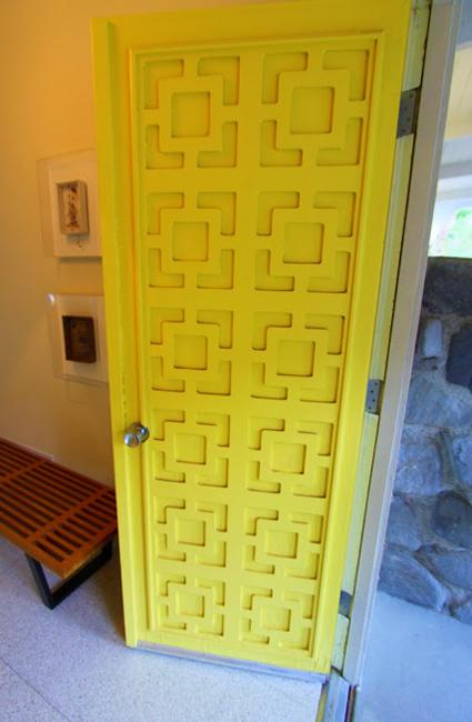yellow door with geometric ornaments