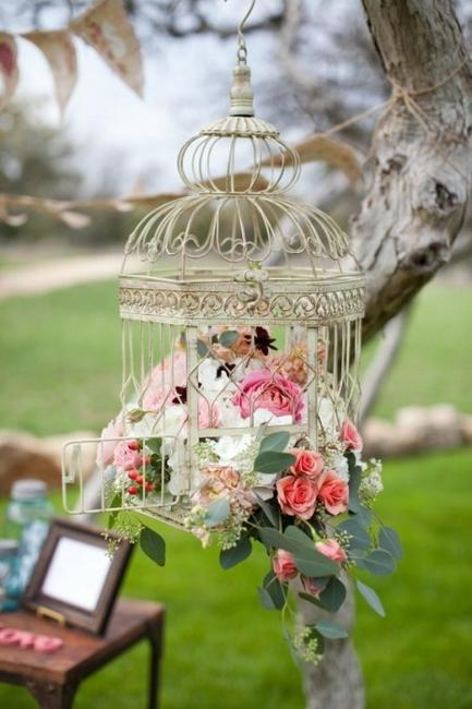 outdoor home decorating with flowers and birdcages