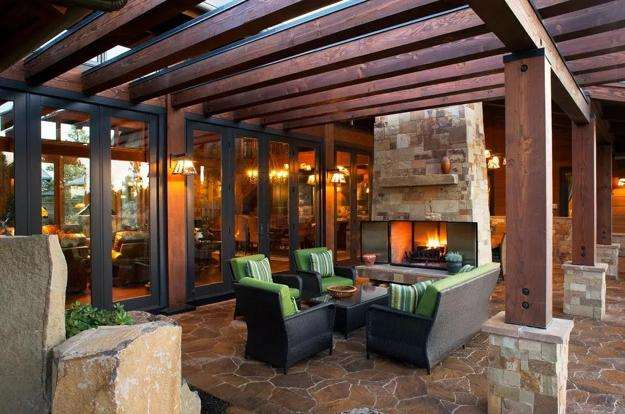 outdoor seating area with stone fireplace