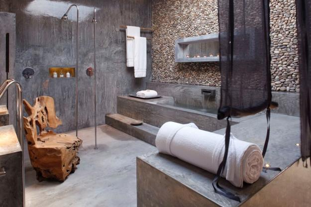 bathroom with concrete floor and stone walls