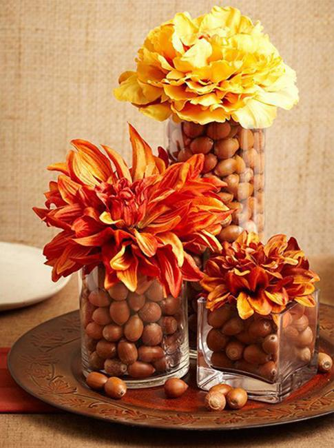 glass vase with acorns and fall flowers