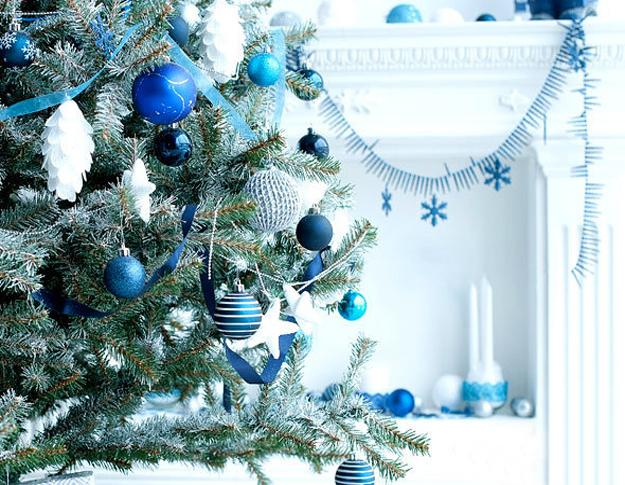 blue christmas balls on branches