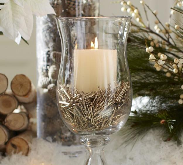 nails and candle in glass centerpiece idea