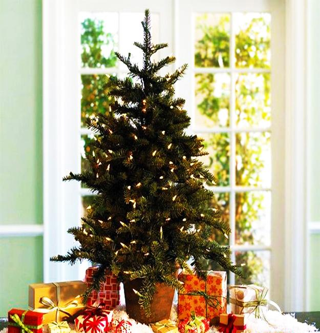 tabletop holiday tree and christmas gift boxes space saving idea for decorating small apartments
