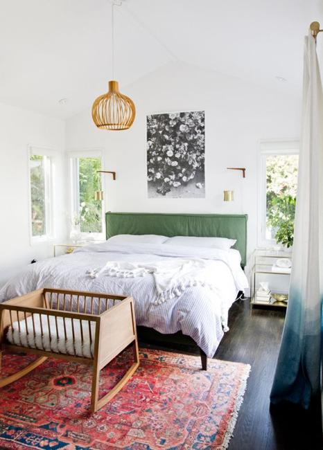 bed with green headboard