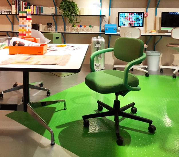 green office chair and floor painting
