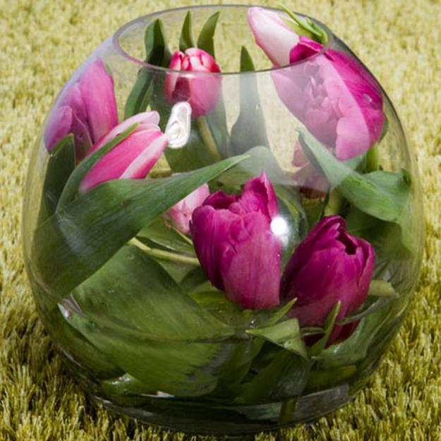 glass vase with floating tulips