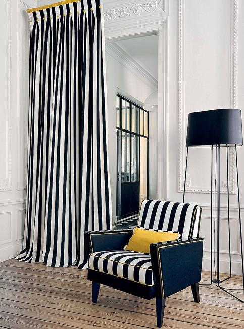 black white striped curtains and chair