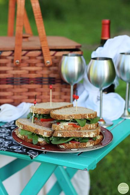 sandwiches and metal wine glasses