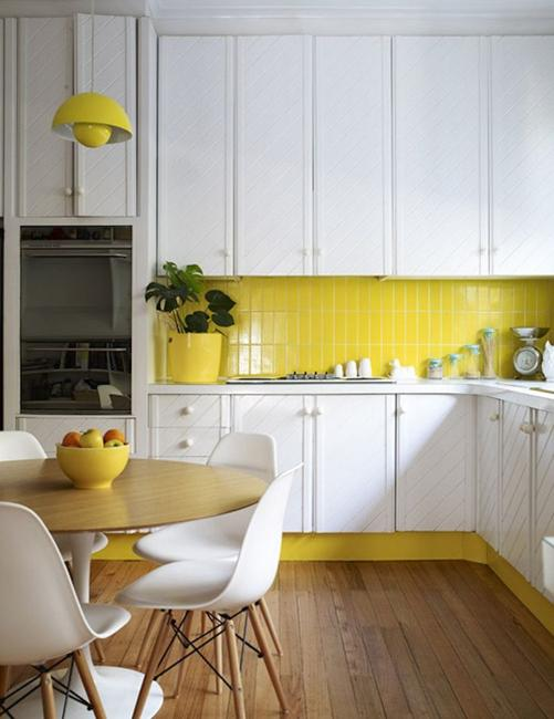 white kitchen yellow backsplash design