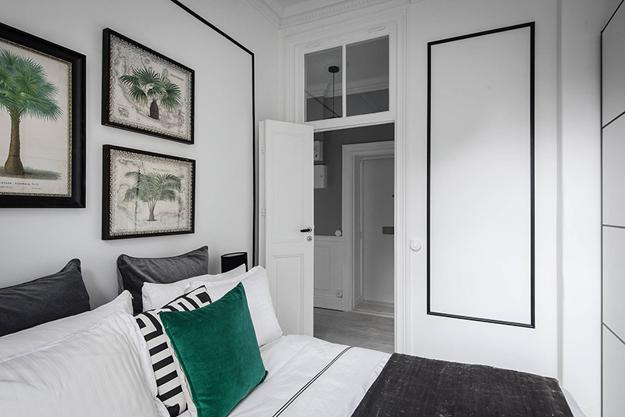 green pillow black white bedroom