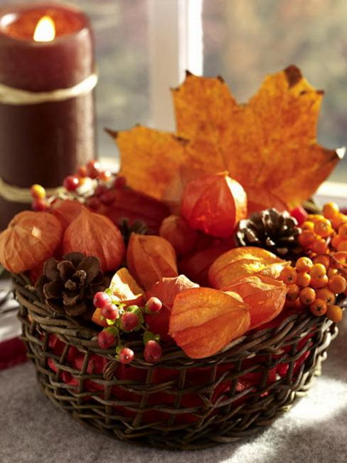 basket with autumn leaves and berries